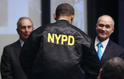 U.S. President Obama is presented with a jacket by  Police Commissioner Kelly during a visit to the Real Time Crime Center in New York