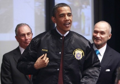 U.S. President Barack Obama is presented with a jacket by  Police Commissioner Kelly at One Police Plaza in  New York